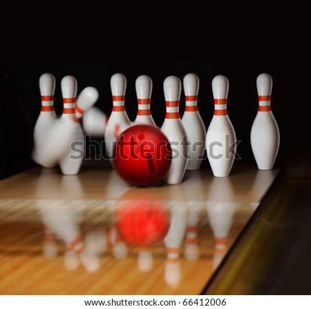 orange ball does strike on tenpin bowling in skittle-ground