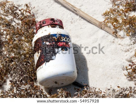 ORANGE BEACH, AL - JUNE 10: A plastic bottle covered with thick black oil washes ashore on June 10, 2010 at Perdido Pass, AL.