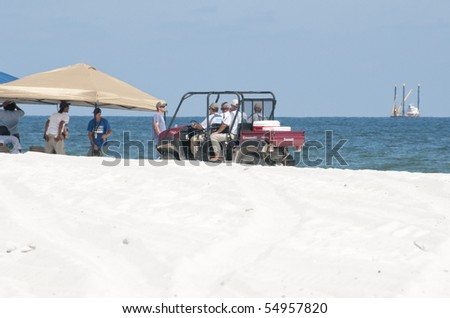 ORANGE BEACH, AL - JUNE 10:  Oil spill workers attempt to clean up oil along the beach in a tourist resort on June 10, 2010 in Orange Beach, AL. The beach is empty except for the workers in the height of the tourism season.