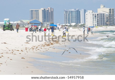 ORANGE BEACH, AL - JUNE 10:  Oil spill workers on the beaches of the Orange Beach, AL resort area on June 10, 2010  as oil washes ashore in the popular tourist region.