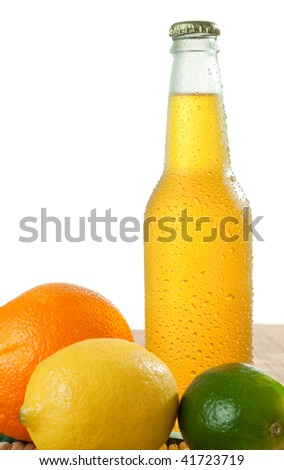 Orange beverage in wet glass bottle