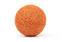 Orange big thread ball isolated on white background. Ball of natural cotton string.