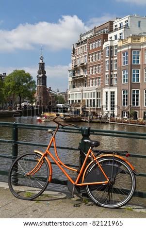 Orange bike in Amsterdam, Holland - stock photo