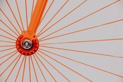 Orange bike spokes and gears.