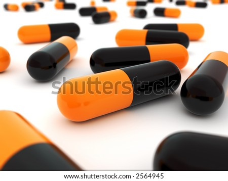 Orange black -Pills, close up. Poison (danger) concept