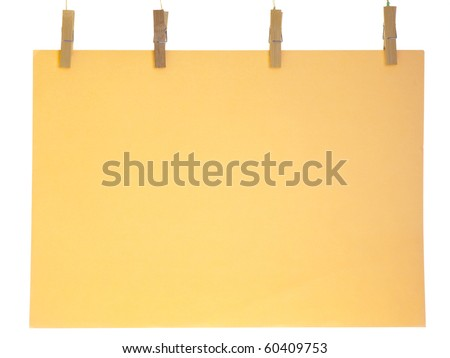 Orange blank paper sheet on a clothes line. Isolated on white background.