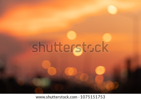 Orange bokeh from street lights and orange sky in the evening. #1075151753