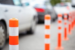 Orange bollard on the road. Traffic jam.