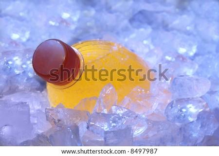 orange bottle in ice