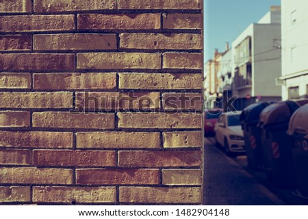 Orange brick wall on a urban outdoor scene with nobody on the still
