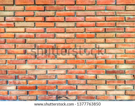 Orange brick wall with grooves