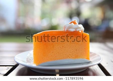 Orange cake on wood background