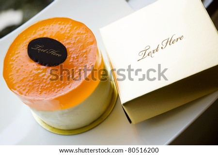 orange cake with golden box