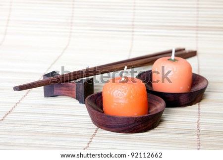 orange candle with chopstick