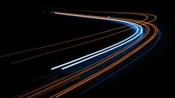 orange car lights at night. long exposure
