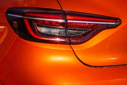 Orange car taillights. Exterior detail. Close up detail on one of the LED taillights modern car.