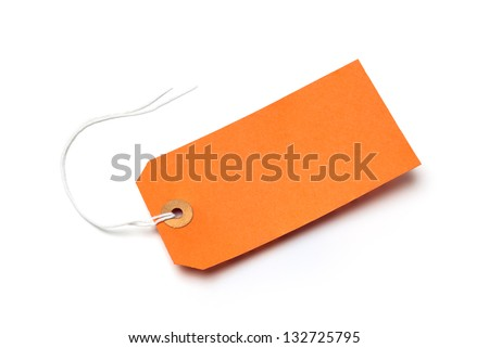 Orange cardboard or paper luggage tag with string and shadow, isolated on a white background