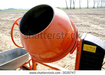 Orange Cement Mixer  Building Activity - stock photo
