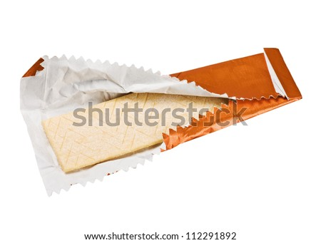 orange chewing gum is on the white background with paper
