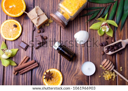 Orange, chocolate, cinnamon. Spa set on a wooden background. View from above