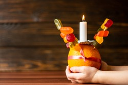 Orange Christingle is a symbolic object used in the Advent, Christmas and Epiphany services of many Christian denominations