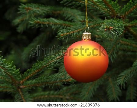 Orange Christmas ball hanging on a Christmas tree