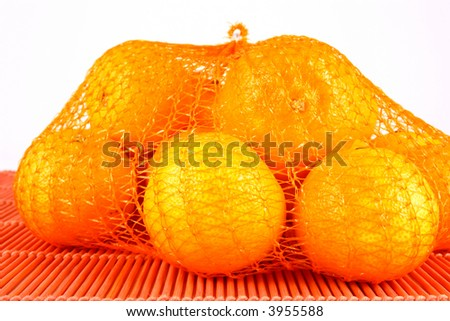 orange Clementines in a netted bag and box