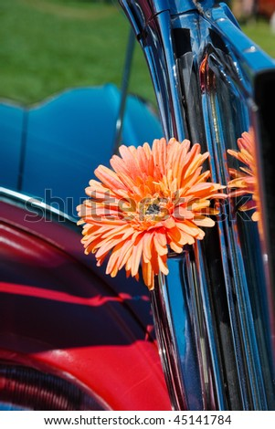 Orange cloth flower on the inside window - stock photo