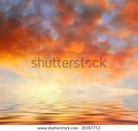 Orange clouds sunset reflecting in water.
