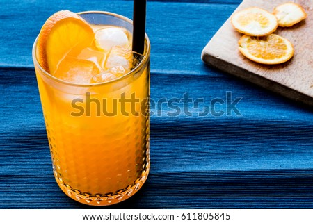Orange Cocktail with ice cubes. #611805845