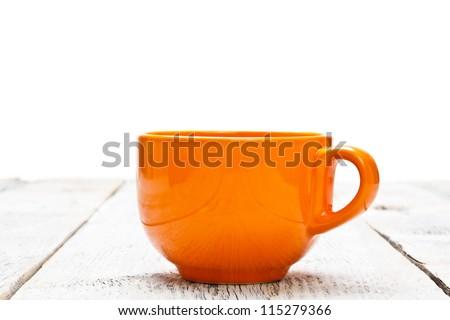Orange coffee cup on wood table