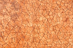 Orange concrete pavement texture on top view.