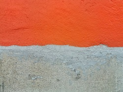 Orange concrete wall and unpainted walls. Rough surface.