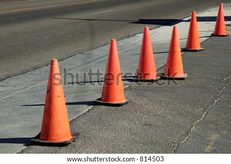 Orange cones used to close off a street. - stock photo