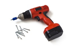 Orange cordless screwdriver or electric drill and black screws on an isolated white background