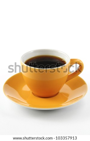 orange cup of coffee on white background