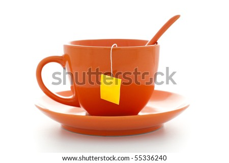 orange cup of tea with saucer and tea bag inside with empty yellow label