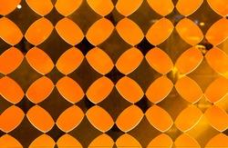 Orange decorative translucent glass with a diamond pattern.