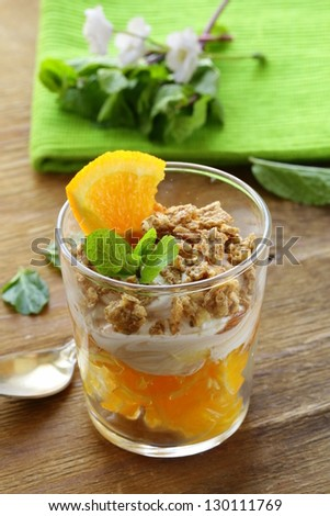 orange dessert with cream and biscuits in a glass - stock photo