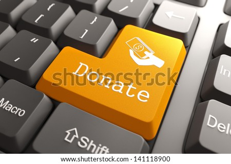 Orange Donate Button on Computer Keyboard. Internet Concept.