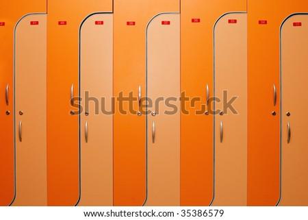 Orange dors of lockers witn nombers