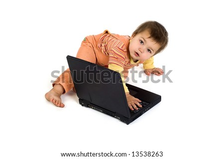 Orange dressed boy working on laptop