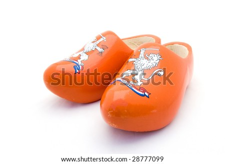 Orange Dutch wooden shoes on a white background
