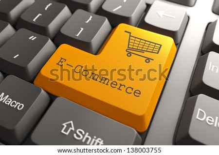 Orange E-Commerce Button on Computer Keyboard. Internet Concept.
