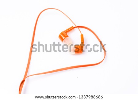 Orange earphones isolated from the background
