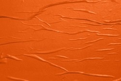 Orange empty crumpled and wet texture paper. Creased grunge paper background. Art rough stylized blank for a billboard, poster or banner with space for text. Copy space.