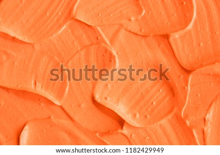 Orange facial mask (pumpkin cream, body scrub) texture close up. Abstract background with brush strokes.   #1182429949