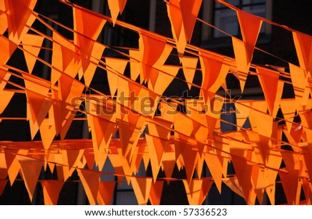 Orange flags during the world cup soccer. Flags and color also used at queens day in Holland.