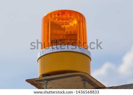 Orange flashing and revolving light on sky background #1436568833