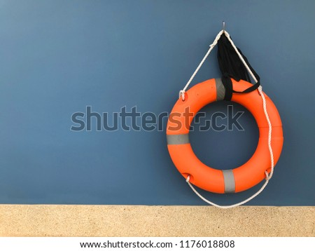 Orange float ring in the wall blue